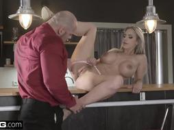 Seductive blonde woman with big, firm boobs, Nathaly Cherie is having anal sex in the kitchen